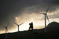 Photographer taking beautiful sunset pictures by Eolic park, wind power, wind energi, Codes mountains, Navarra, Spain, Europe