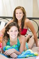 teenagers lounging poolside