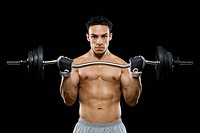 Portrait of a mid adult man lifting a barbell