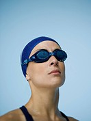 Close_up of a woman wearing swimming goggles and a swimming cap