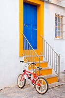 Ibiza white facade in blue door stairs