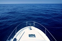 Bow of yacht white boat cruing the blue sea