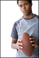 Portrait of a teenage boy holding a football