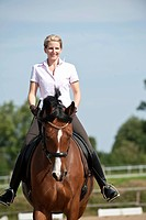 Woman riding a Hanoverian horse