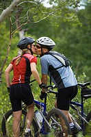 Rear view of a couple mountain biking