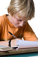 Close_up of a boy doing homework