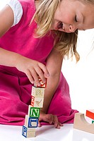 Close_up of a girl playing with blocks