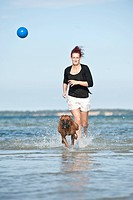 Woman playing with a Boxer in the water, Baltic Sea, Mecklenburg-Western Pomerania, Germany, Europe