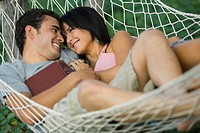 High angle view of a young couple relaxing in a hammock