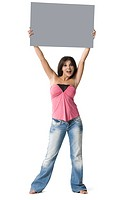 Portrait of a mid adult woman lifting up a placard