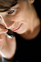 Close_up of a mid adult woman talking on the mobile phone