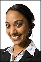 Portrait of woman with headset smiling
