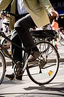 Waist down view of man riding bicycle