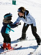 Woman and young girl skiing