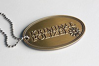 A brass badge with Kriminal Polizei, German for Crime Police