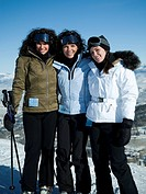 Three women outdoors in winter skiing