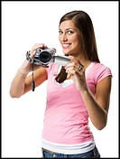 Portrait of a young woman holding a home video camera