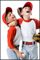 Close_up of two baseball players smiling