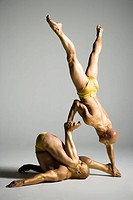 Two male acrobats performing
