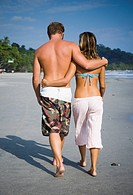 Romantic couple strolling on the beach