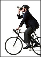 Profile of a businessman cycling and holding from a mug