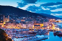 France, Corsica, Haute-Corse Department, Le Cap Corse, Bastia, elevated view of the Old Port, dusk