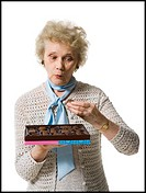 Older woman holding a box of chocolates