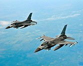 Two F-16 Fighting Hornets from 148th Fighter Wing out of Duluth, Minn , prepare to fly in formation behind the boom of a KC-135R Stratotanker from the...