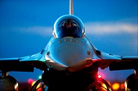 An F-16 Fighting Falcon pilot waits to taxi out for a night mission during exercise Green Flag-West 13-02 at Nellis Air Force Base, Nev , Nov  1, 2012...