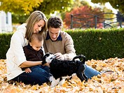 young family with a puppy