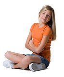 Girl sitting with arms and legs crossed