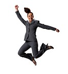 Businesswoman jumping with arms raised