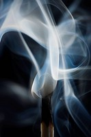 Smoking match against black background