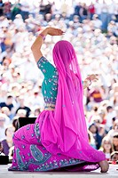USA, Utah, Spanish Fork, rear view of mid adult dancer in traditional clothing performing on stage