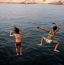 Women jumping into water