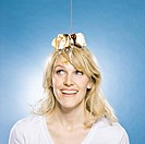 woman with an ice cream sundae on her head