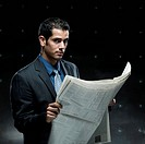 businessman holding a newspaper