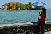 Mah&#233;bourg, Mauritius, woman by the shore