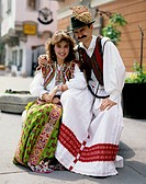 Hungary. Couple posing outdoors in traditional costume.