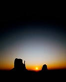 The Rising Sun Pushes the Darkness of Night Away and Silhouettes the Mitten Buttes