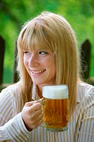 woman with beer glass in the garden