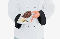 Chef offering garnished chocolate pastry