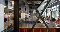 Jamie´s Italian Portsmouth, Portsmouth, United Kingdom. Architect: Stiff + Trevillion Architects, 2012. General panoramic view of restaurant´s interio...