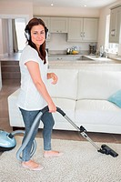 Woman cleaning wearing headphones