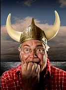 MAN WITH VIKING HELMET AFRAID,MODEL RELEASE