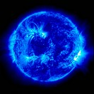 In a blue extreme ultraviolet image of the Sun ionized iron at 171 angstroms, two large active regions, one in the center, and another on the right li...
