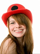 cheerful young girl in a red hat