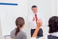 Businessman pointing to colleague raising her hand with big smile