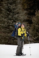 A father and a newborn boy going for a snowshoe at Peter Lougheed Provincial Park, Kananaskis, AB