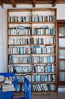colour coordinated outdoor bookcase in holiday villa, south west Turkey